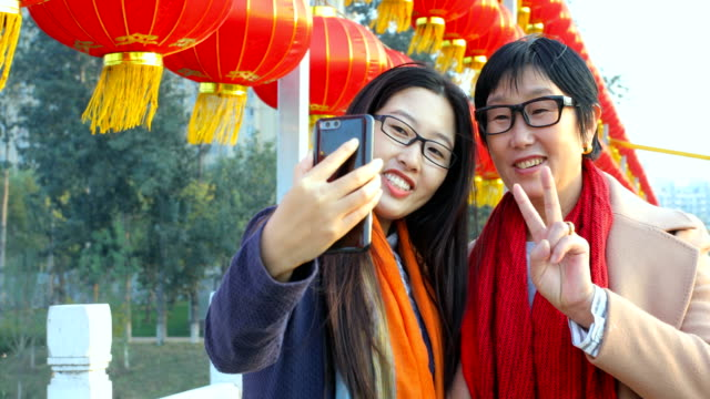 young woman taking selfie with mom - chinese ethnicity stock videos & royalty-free footage