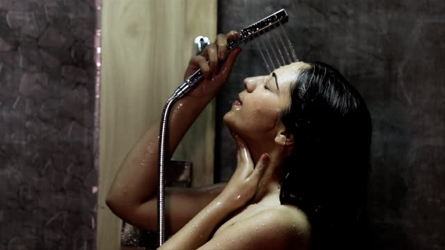 stockvideo's en b-roll-footage met young woman taking shower in bathroom, delhi, india - indisch subcontinent etniciteit