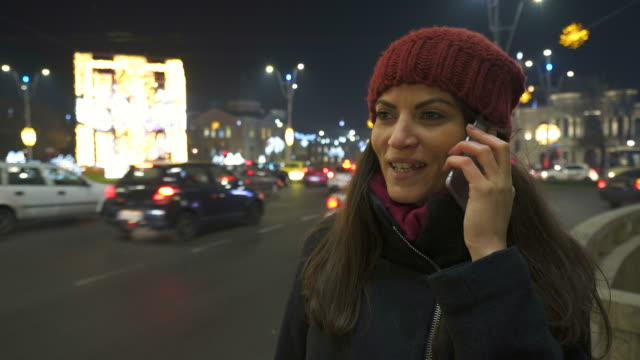 Young woman talking at mobile phone.