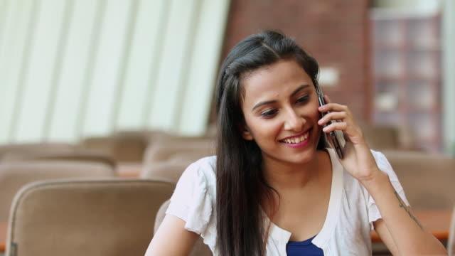 Young woman talking on a mobile phone, Noida, Uttar Pradesh, India