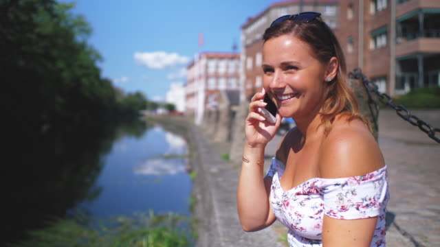 young woman talking on a mobile phone - tan stock videos and b-roll footage