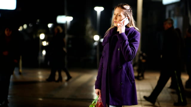 young woman talking on phone - coat stock videos & royalty-free footage