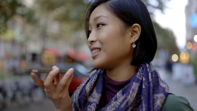 young woman talking on smartphone in city - short hair stock videos & royalty-free footage