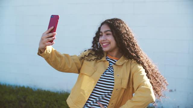 cu young woman talking on the phone, taking a selfie - tuff attityd bildbanksvideor och videomaterial från bakom kulisserna
