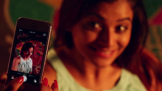 Young woman talking selfie with a mobile phone in diwali festival