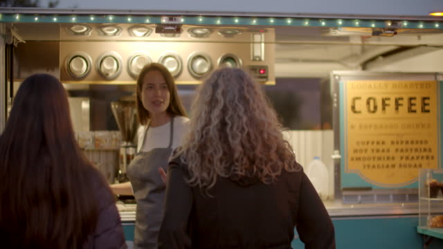 young woman talking to customers at her food truck - selling stock videos & royalty-free footage