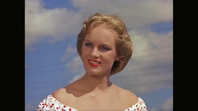 vidéos et rushes de ms young woman talking while looking away / united states - 1950 1959
