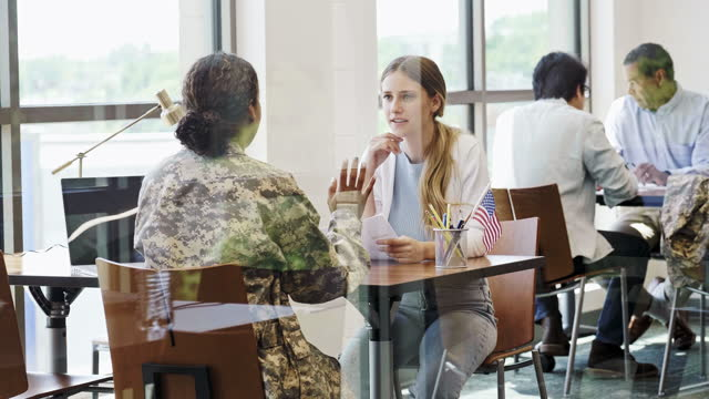 young woman talking with military recruiter - military recruit stock videos & royalty-free footage