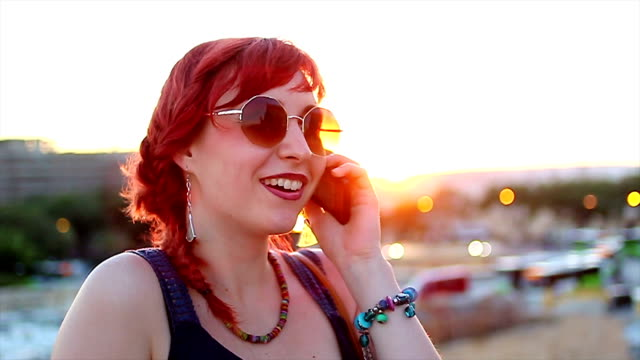 young woman talking with smart phone - malta stock videos & royalty-free footage