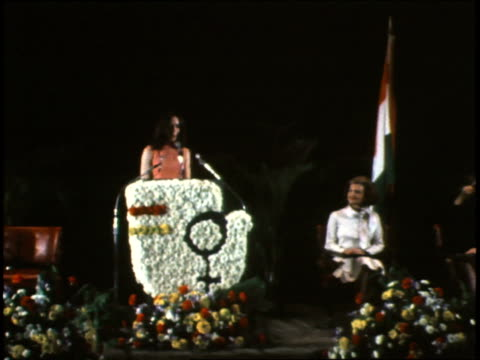 a young woman talks to the audience from the podium thanking betty ford for her work / betty ford waving to he crowd betty ford speaks at the... - short phrase stock videos and b-roll footage