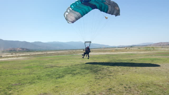 young woman tandem parachute landing - caucasian appearance stock videos & royalty-free footage