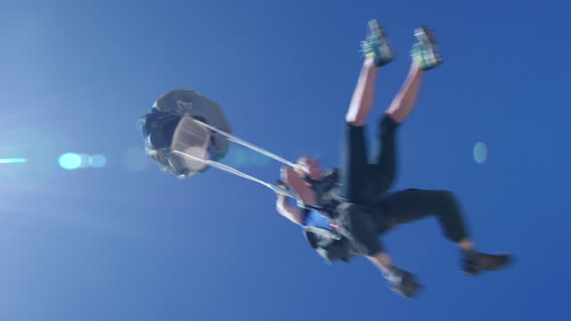 young woman tandem parachute opening - caucasian appearance stock videos & royalty-free footage