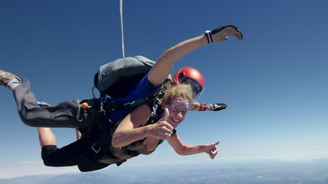 young woman tandem skydiving - caucasian appearance stock videos & royalty-free footage