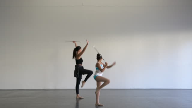 ws young woman teaching baton twirling in a dance studio - trainer stock videos & royalty-free footage