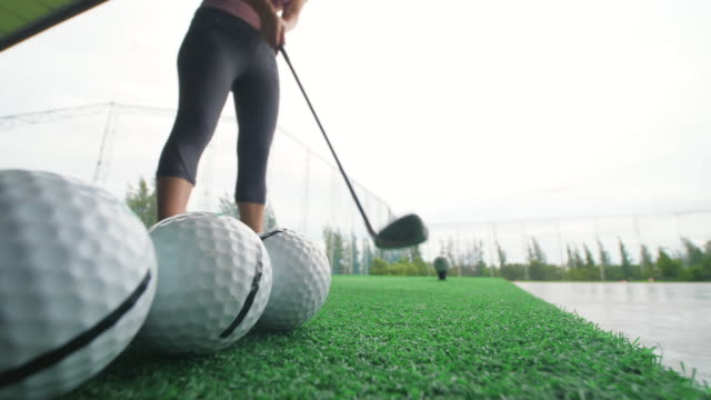 young woman test driver golf swing - only young women stock videos & royalty-free footage