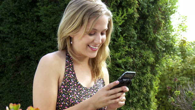 ws tu zi zo young woman text massaging on smart phone / sherman oaks, california, usa. - see other clips from this shoot 1655 stock videos & royalty-free footage