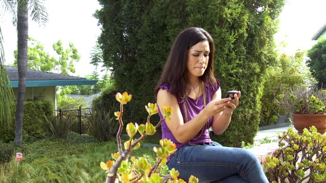 ms zi young woman text messaging on mobile phone / sherman oaks, california, usa.  - sherman oaks stock videos & royalty-free footage