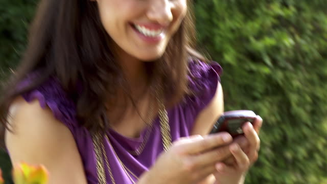 cu zi zo tu td young woman text messaging on mobile phone / sherman oaks, california, usa.  - see other clips from this shoot 1655 stock videos & royalty-free footage