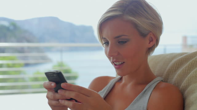 cu young woman texting on mobile device / andratx, mallorca, spain - kurzes haar stock-videos und b-roll-filmmaterial