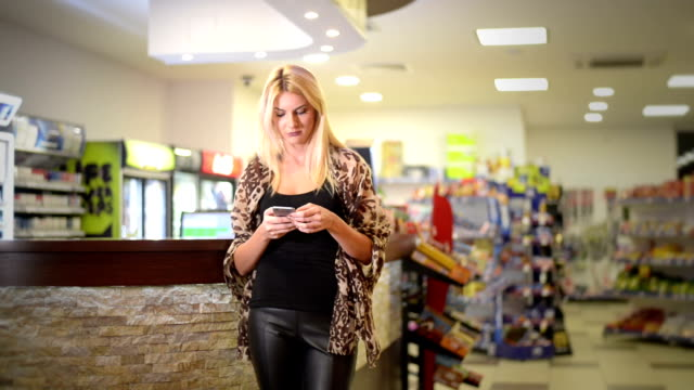 young woman texting - petrol stock videos and b-roll footage