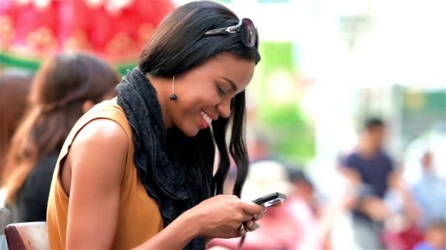 young woman texting - text messaging stock videos & royalty-free footage