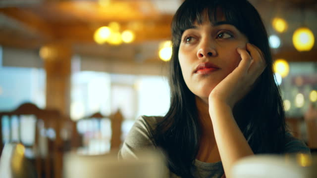 young woman thinks in dull summer day on restaurant's table. - waiting stock videos & royalty-free footage