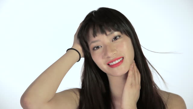 young woman touching hair and face, breeze blowing - bangs stock videos and b-roll footage