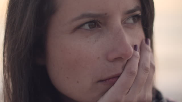 cu young woman touching her face looking sad - human face stock videos & royalty-free footage