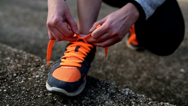 young woman trail runner tying shoelaces - tie stock videos & royalty-free footage