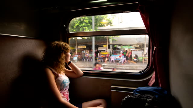 young woman traveling in train - looking at view stock videos & royalty-free footage