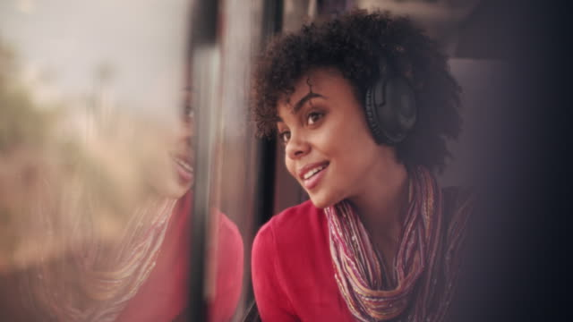 cu young woman traveling on a train - listening stock videos & royalty-free footage