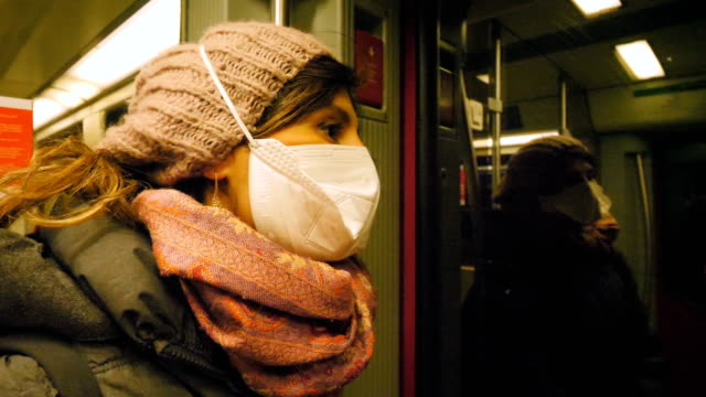 young woman travelling by subway wearing a mask - passenger train stock videos & royalty-free footage