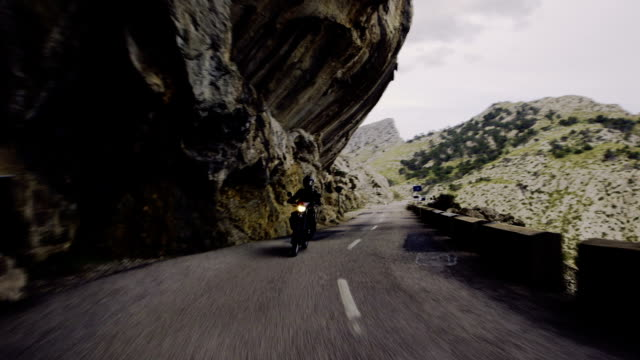 young woman travelling on a motorcycle. rocky landscape - motorcycle stock videos and b-roll footage