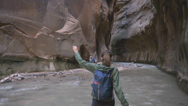 4k uhd: young woman treading through the narrows - national park stock videos & royalty-free footage