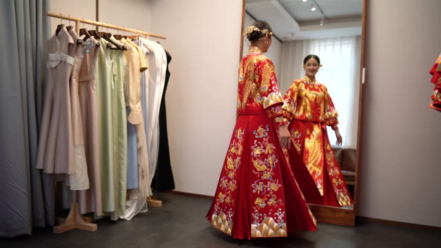 young woman trying on a traditional wedding dress - silk stock videos & royalty-free footage