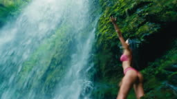 Young Woman Under Waterfall