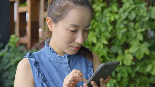 young woman use of mobile phone - only japanese stock videos & royalty-free footage