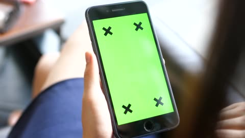 young woman uses smartphone with green screen - human hand stock videos & royalty-free footage