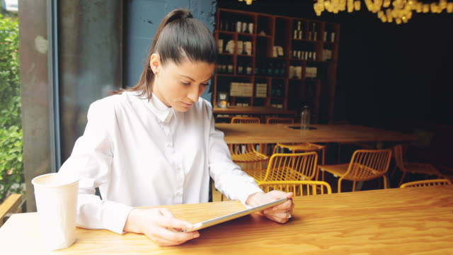 Young woman using a digital tablet.