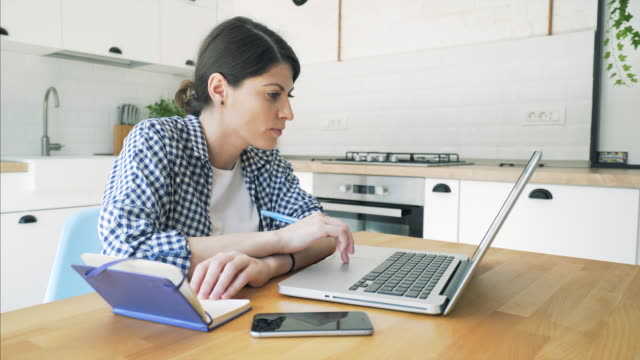Young woman using a laptop.