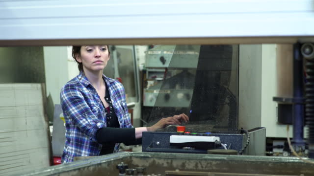 young woman using a water jet cutter - genderblend stock videos & royalty-free footage