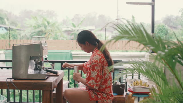 young woman using coffee grinder at home. - kitchenware department stock videos and b-roll footage