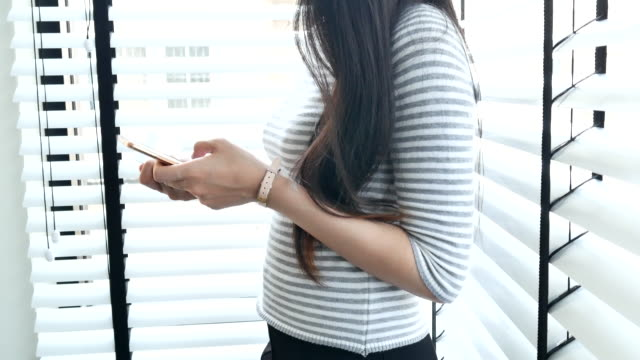 Young woman using Digital Tablet for shopping