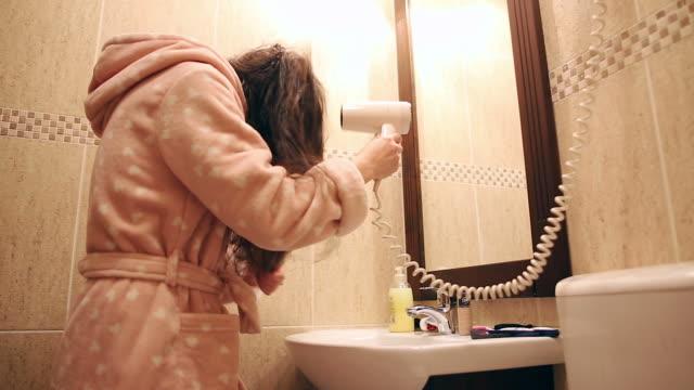 young woman using hairdryer. - drying stock videos and b-roll footage