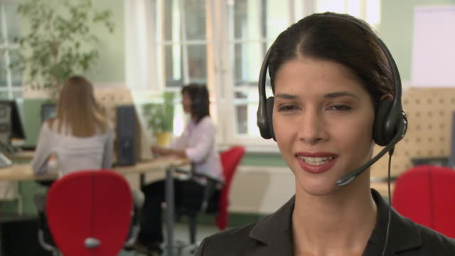 vídeos y material grabado en eventos de stock de cu, selective focus, young woman using headset in call center - call center latino