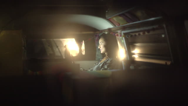 young woman using her laptop in her camper van - bus stock videos & royalty-free footage