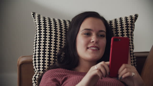 cu young woman using her phone - brown hair stock videos & royalty-free footage