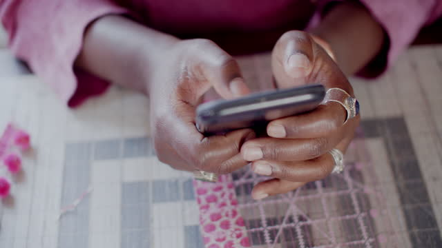 cu young woman using her phone while working - braided hair stock videos & royalty-free footage