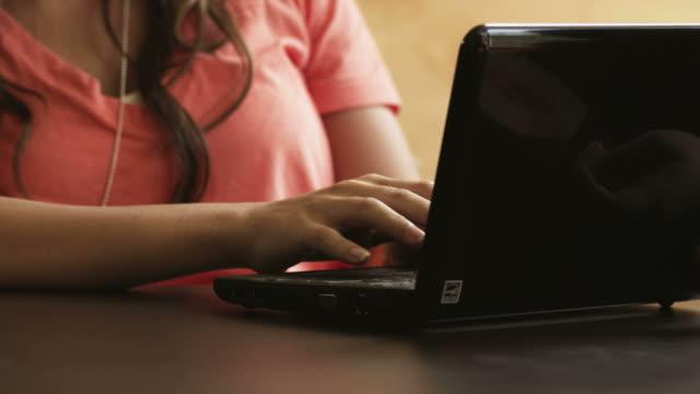 CU TD TU Young woman using laptop, Provo, Utah, USA