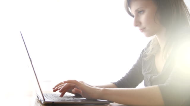 young woman using laptop - e learning stock videos & royalty-free footage